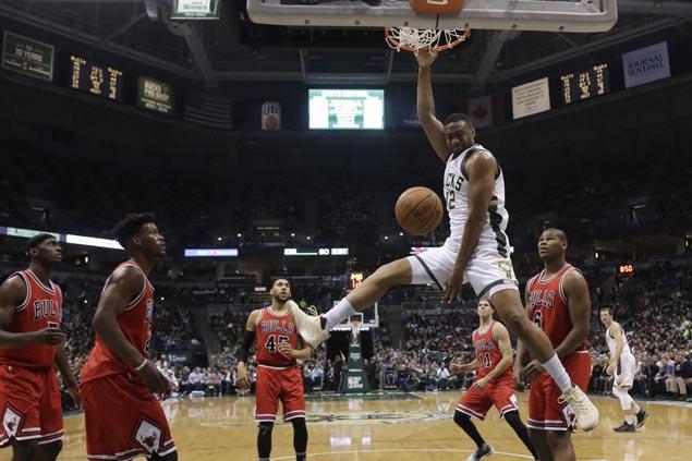 Bucks wax hot early then survive fiery Bulls late rally to break three-game slump