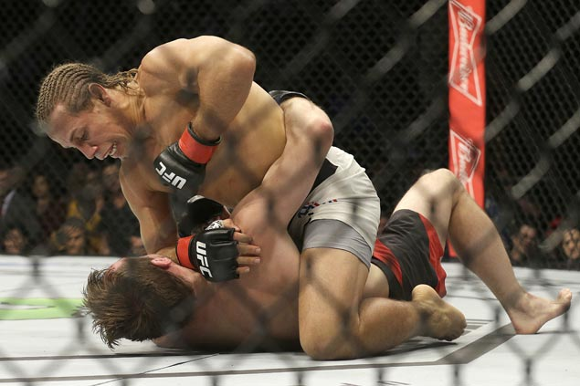 Urijah Faber survives early knockdown in UFC Fight Night to outpoint Brad Pickett in farewell bout