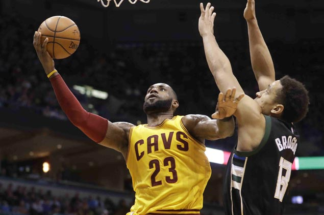 LeBron James passes Moses Malone for eighth on all-time scoring list as Cavs squeak past Bucks