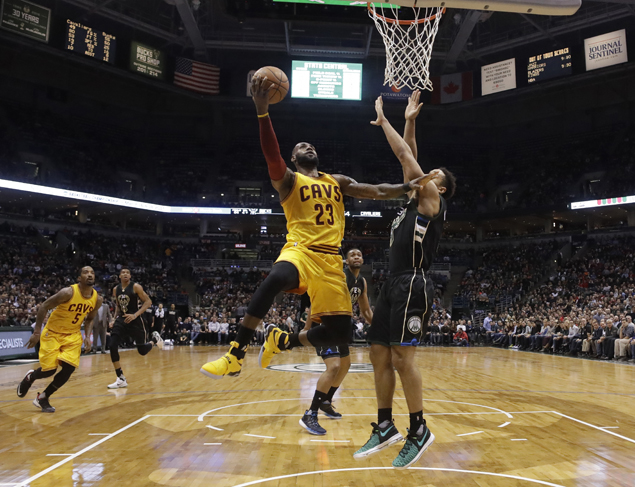 LeBron James feeling it from beyond the arc, shoots down Bucks with five treys