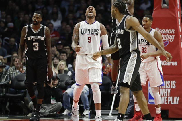 Undermanned Clippers buck late injury on Chris Paul to halt Spurs five-game win run