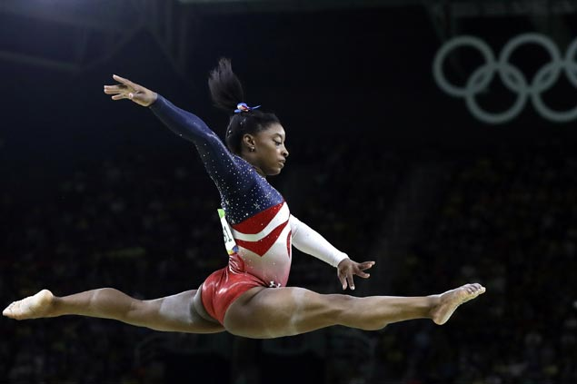Simone Biles picked AP Female Athlete of the Year over fellow teen Olympian Katie Ledecky