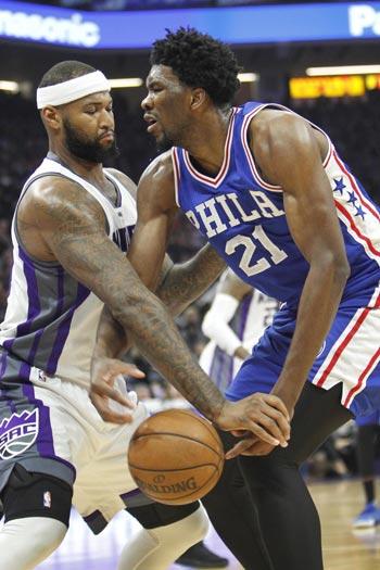 DeMarcus Cousins hits go-ahead triple, makes game-saving block on Joel Embiid as Kings nip Sixers