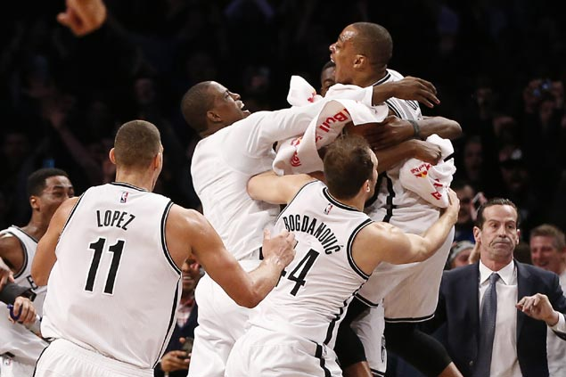 Randy Foye's buzzer-beating triple caps Brooklyn's comeback to stun Charlotte in thriller