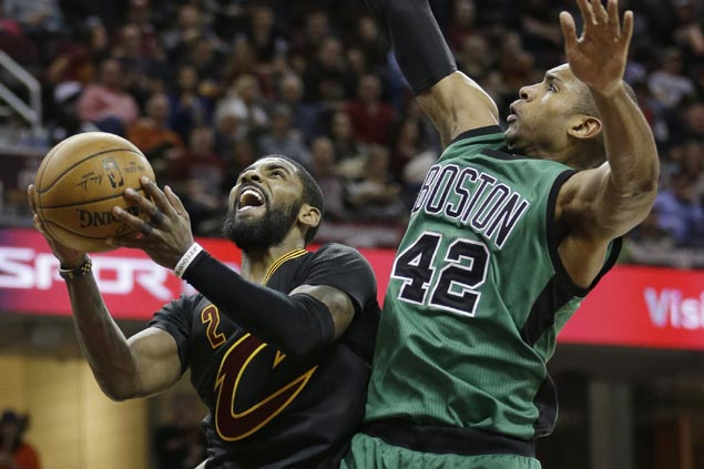 Kevin Love catches fire early, Kyrie Irving takes charge late as Cavs survive furious Celtics rally