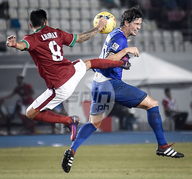 Phil Younghusband takes the hard hit.