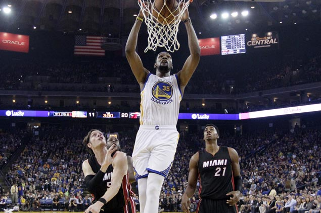 Warriors pull away late to waste Whiteside's 20-20 game and turn back slumping Heat
