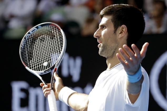 Defending champ Novak Djokovic falls to wildcard Denis Istomin in second round of Aussie Open