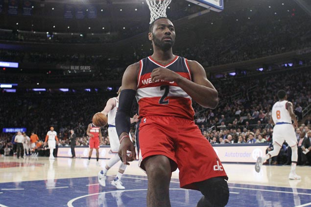 John Wall rescues Wizards from late-game collapse to stun Knicks for fourth straight win