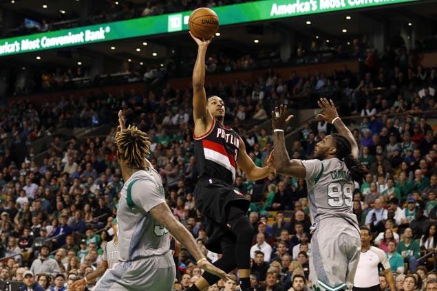 Blazers halt four-game slide with overtime victory over Celtics