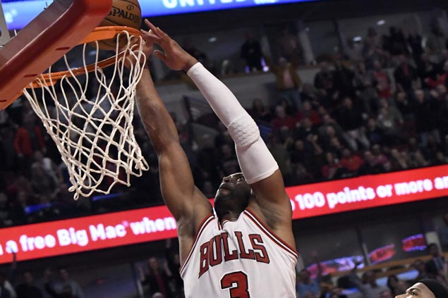 Dwyane Wade steady in fourth as Bulls down Kings and spoil DeMarcus Cousins' 42-point night