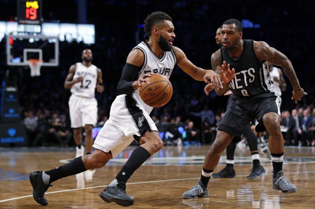 Shorthanded Spurs prove strong enough to clobber hapless Nets for fourth straight win