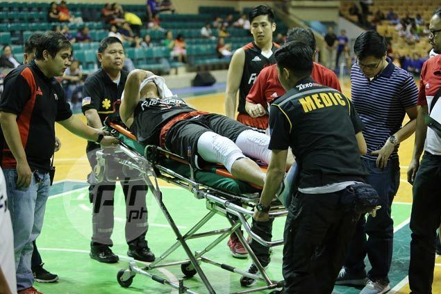 Gilas cadet Russel Escoto suffers scary knee injury in Mahindra game against NLEX
