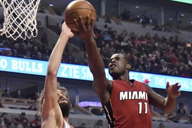 Heat make it six straight wins with rout of struggling Bulls