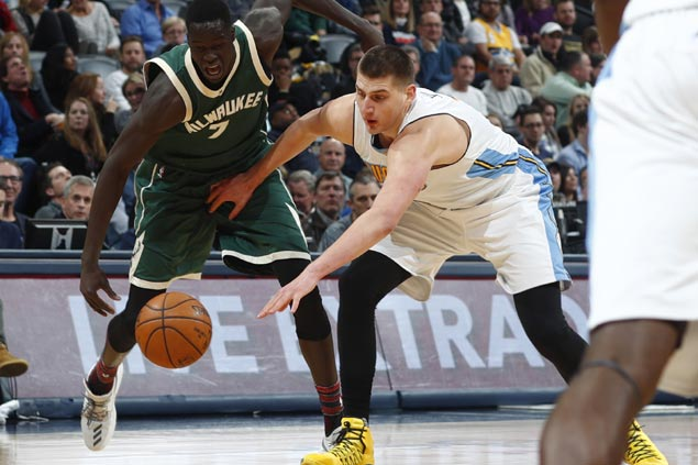 Nikola Jokic nabs first-ever triple-double in return from hip injury as Nuggets hold off Bucks