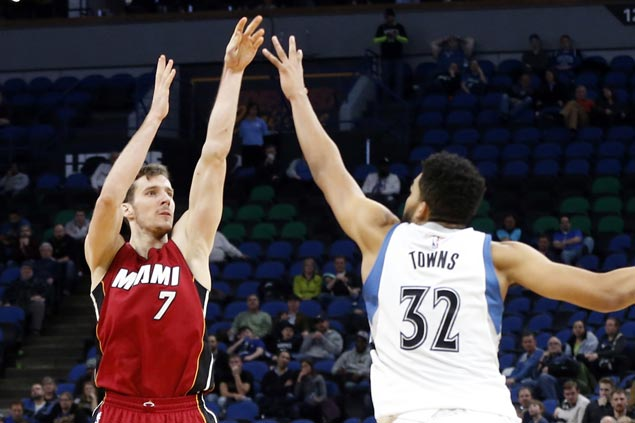 Goran Dragic hits career-high seven triples as Heat down Wolves and extend win run to 11