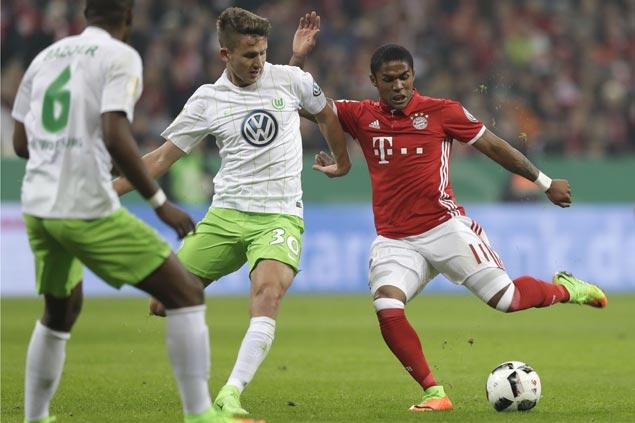 Bayern Munich scrapes past Wolfsburg and into German Cup quarterfinals