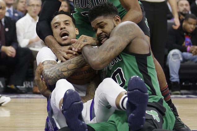 Undermanned Kings buck slow start with scorching finish to halt Celtics' win run at seven