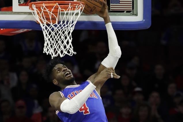 Sixers use balanced offense to end Heat win streak at 13