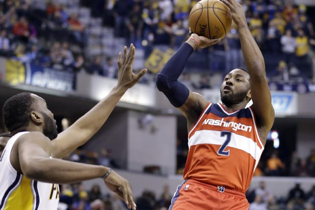 Streaking Wizards ease past struggling Pacers to stretch win run to four