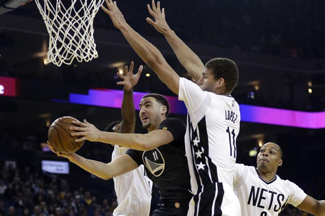 Curry, Thompson show way as KD-less Warriors prove too strong for lowly Nets