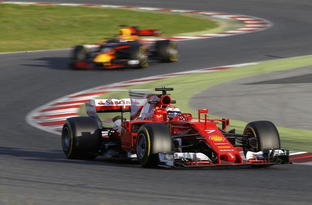 Ferrari's Kimi Raikkonen posts best time, edges Mercedes' Lewis Hamilton on second day of F1 preseason