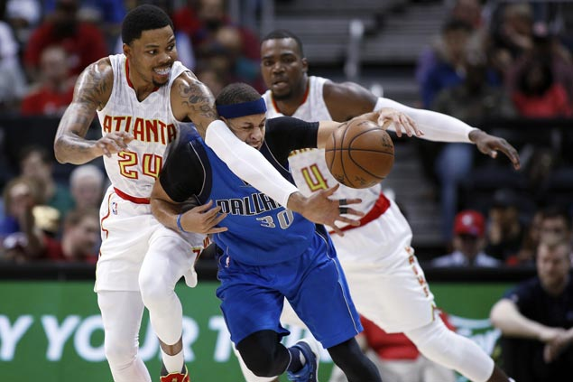 Paul Millsap, Kent Bazemore come up clutch as Hawks ride late flurry to turn back Mavs
