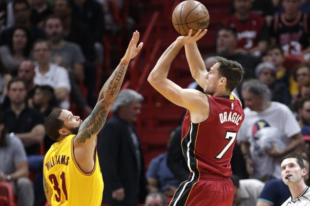 Heat ease to victory as Cavaliers rest Kyrie Irving, LeBron James
