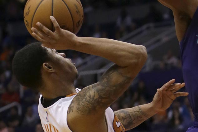 Rookie Tyler Ulis hits 3-pointer at the buzzer to carry Suns past undermanned Celtics