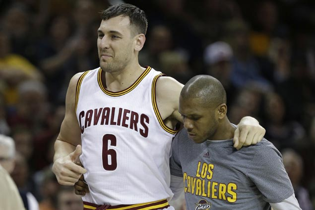 Andrew Bogut debut with Cavs lasts just one minute as Aussie big man suffers leg injury