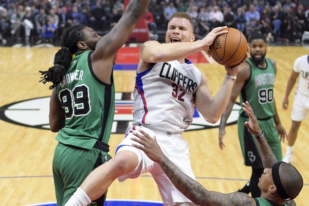 Clippers catch fire in second half and fend off late rally to beat skidding Celtics