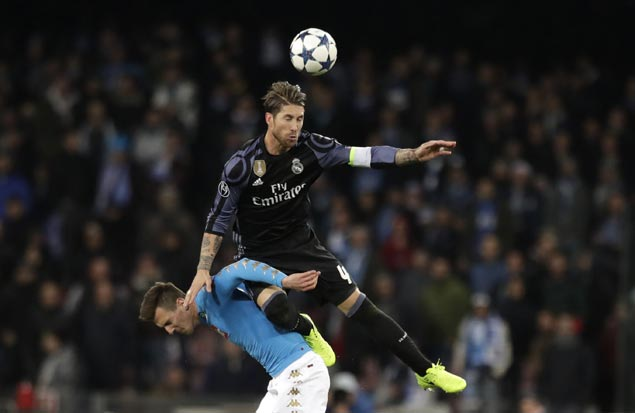 Titleholder Real Madrid marches on to Champions League quarters after early scare from Napoli