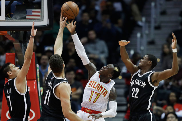 Hawks arrest three-game slide with rout of cellar-dwelling Nets
