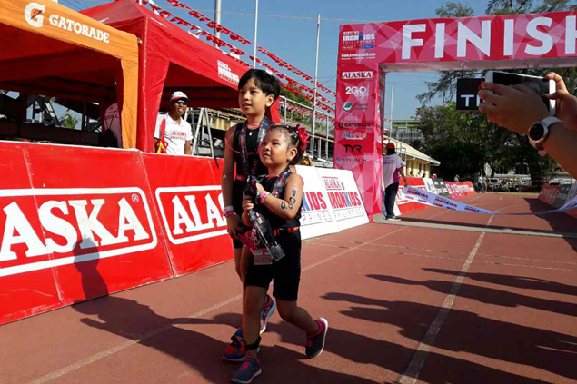 Kids stuff as ultramarathoner mom keeps triathlon fun for her two pride and joy