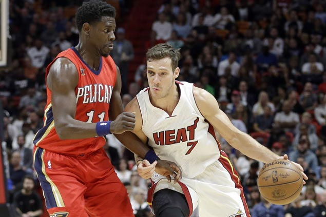 Goran Dragic returns from gruesome eye injury to power Heat past Pelicans