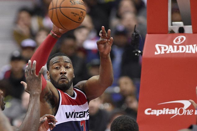 John Wall dishes out career-high 20 assists as Wizards down Wade-less Bulls