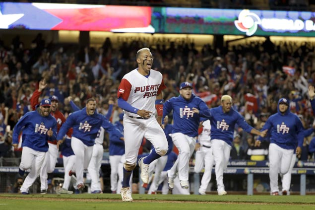 Eddie Rosario's 11th-inning sacrifice fly helps Puerto Rico edge Netherlands to reach WBC finals