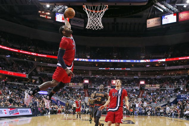 Beal, Wall lead strong finish to help Wizards overcome slow start against slumping Hawks