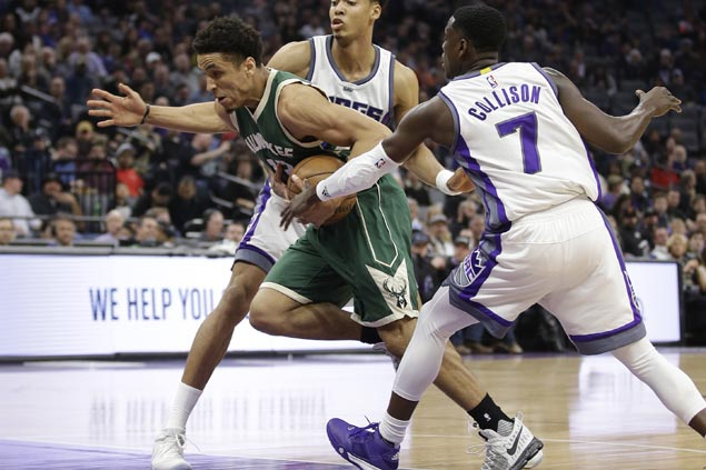 Streaking Bucks sink 16 triples to cruise to victory over struggling Kings