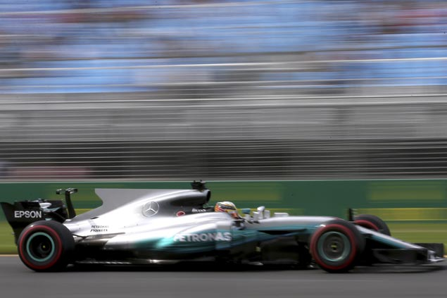 Mercedes' Lewis Hamilton posts fastest time in first practice for new Formula One season