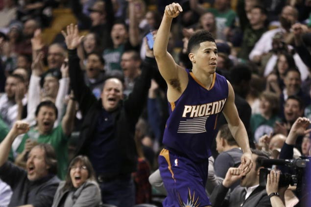 Celtics fans roar, players frown as Devin Booker becomes youngest to score 70 in loss to Boston