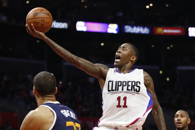 Clippers overcome third-quarter wobble to beat Jazz and secure place in playoffs