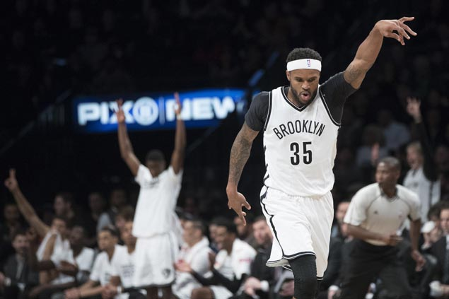 Brook Lopez, Trevor Booker spark Nets rally in fourth to stun fellow struggler Magic