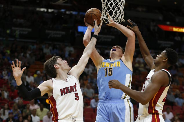 Nuggets beat Heat to end three-game slide and keep playoff hopes alive