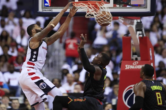 Roughed-up Paul Millsap vows to match Morris' 'MMA' style of play after loss to Wizards