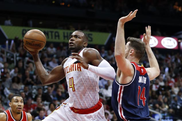 Hawks use balanced scoring to even series with Wizards