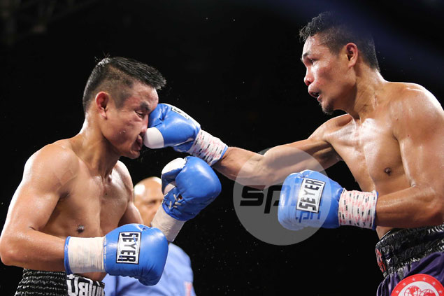 Donnie Nietes wins third world title after scoring a gutsy unanimous decision over tough Thai foe