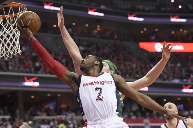 Wizards ride huge third quarter to rout Celtics and even semis series
