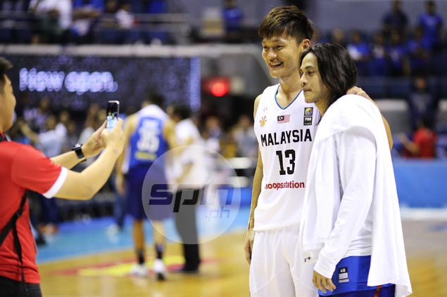 Rivals turn into fans as Malaysian players take selfies with Terrence Romeo after Gilas romp