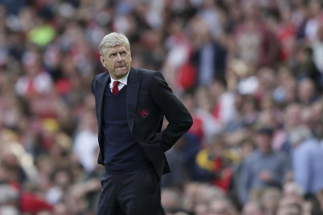 Arsene Wenger signs new two-year deal to extend 21-year reign as manager of Arsenal